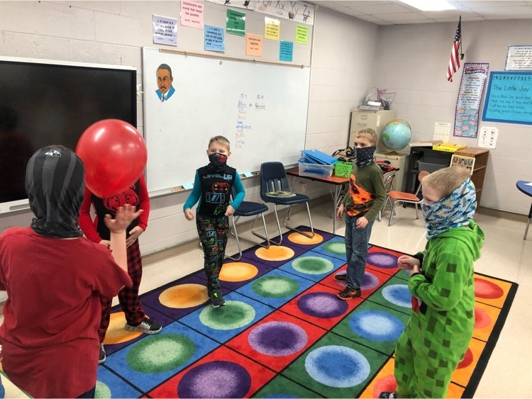 2nd grade students are working together to keep the balloon in the air for 100 seconds on the 100th day of school!