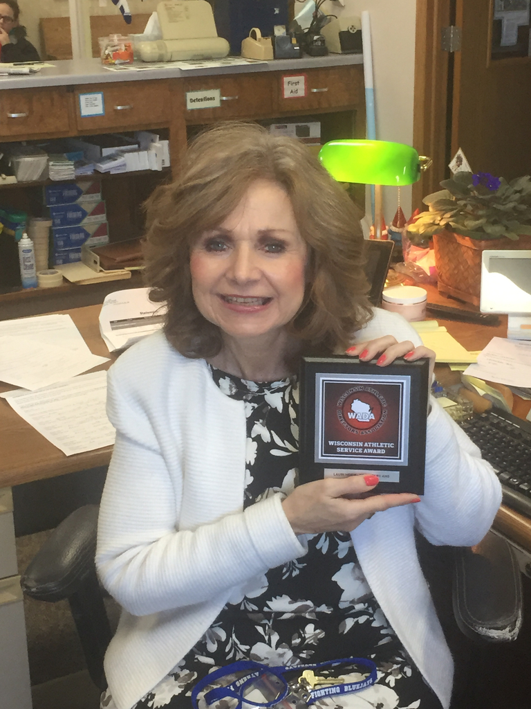 Ms. Heier and her award.