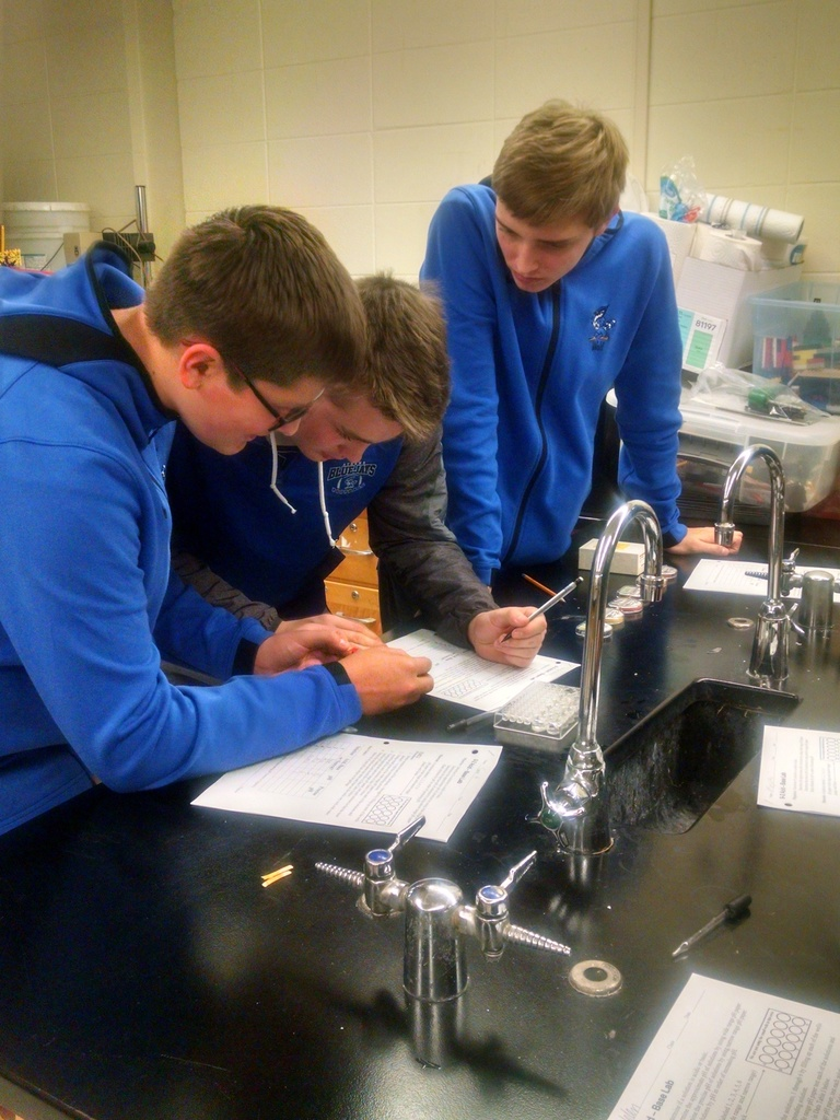 Physical science students are determining the pH of an unknown solution.