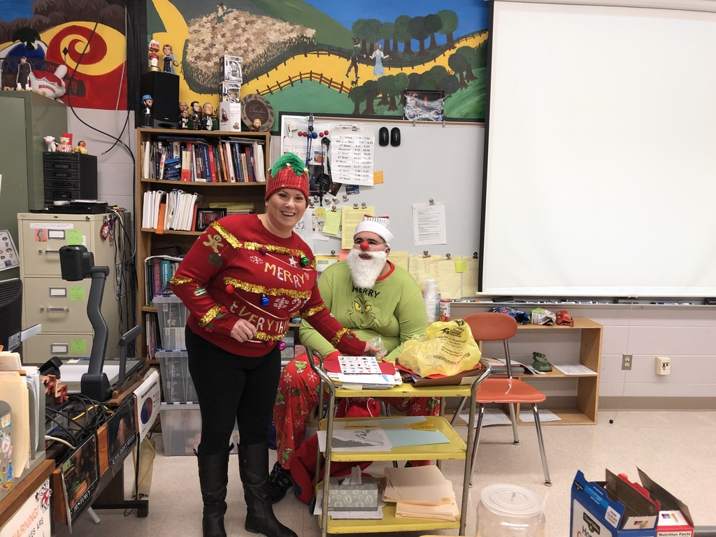 Mrs.Gauerke with our Grinch adding a festive twist to US1.