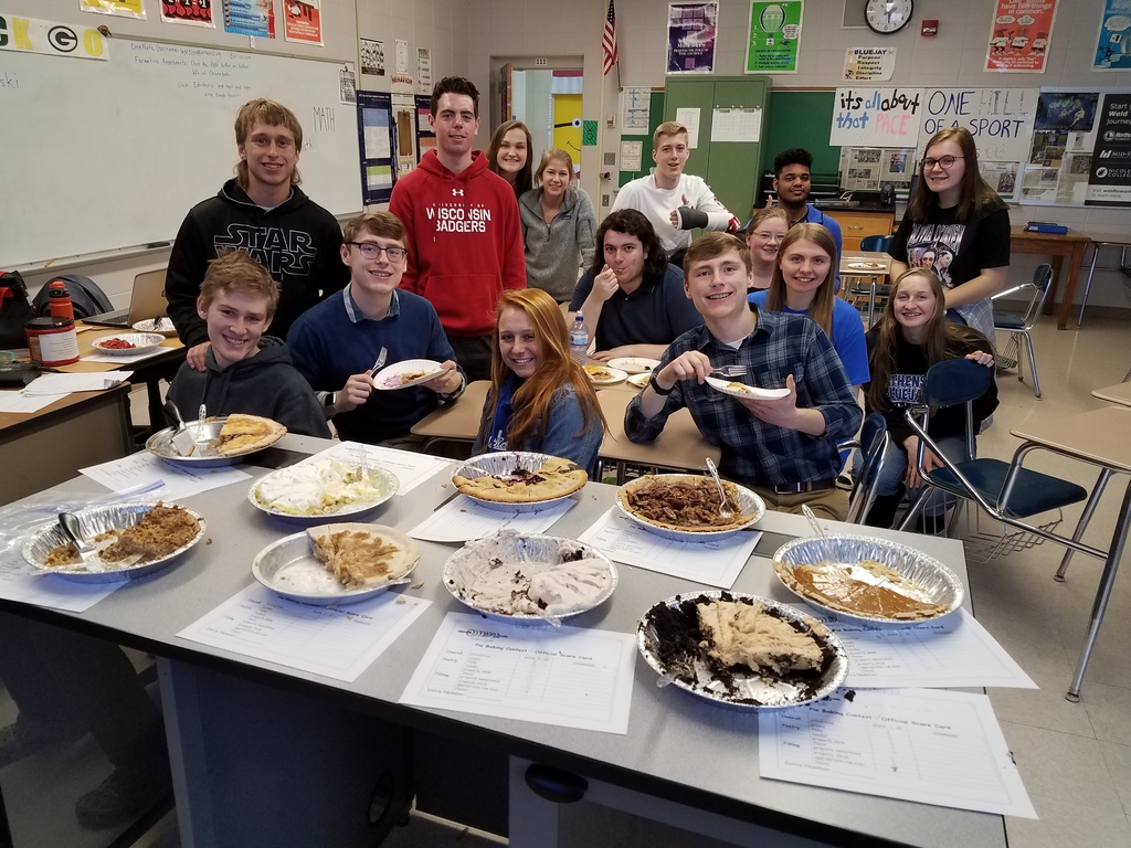 Calculus students eating pie for Pi Day!