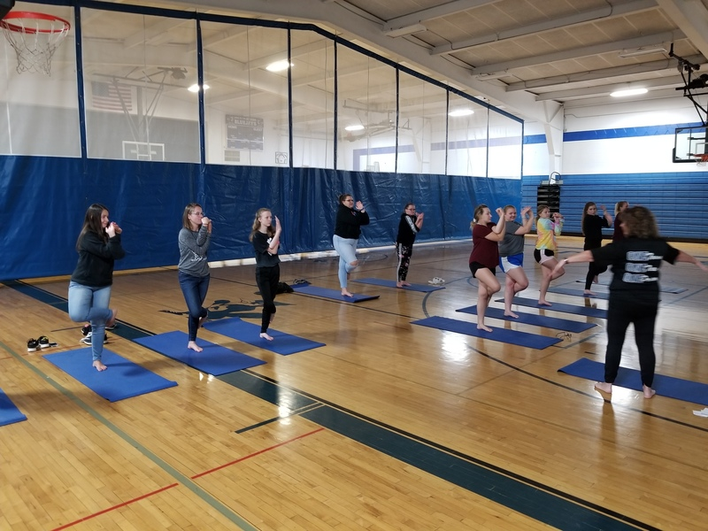 Student Participating in YOGA during FLEX